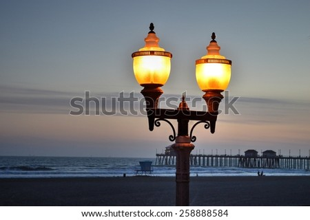 Lamppost by the Pier at dusk - stock photo