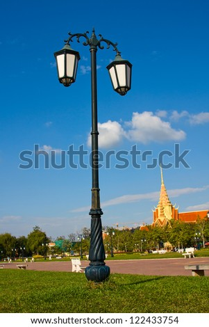 Lamppost in the park in Phnom Penh, Cambodia - stock photo