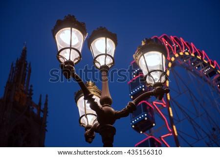 lamppost on Ferris wheel background - stock photo