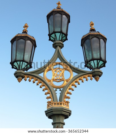 Lamppost on Westminster Bridge in Central London - stock photo