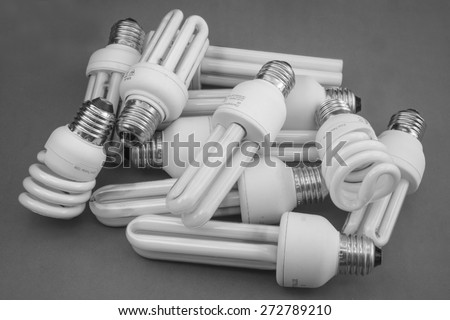 Lamps of energy saving in black and white - stock photo