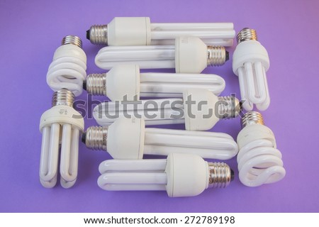 Lamps of energy saving with purple background - stock photo