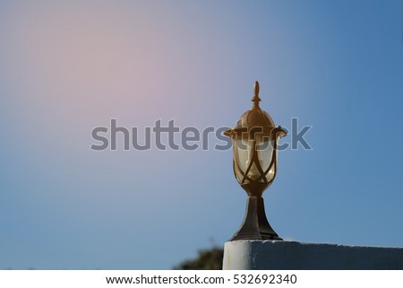 Lamps on blue sky background