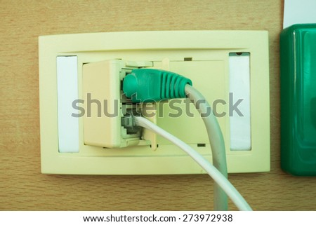 Lan and telephone cable plug in  - stock photo