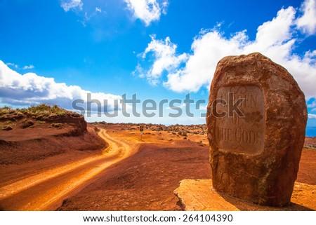 Lanai, Hawaii.  Garden of the Gods.  Dirt road and rock. - stock photo