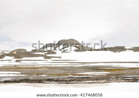 Land and mountain snow at Antarctica  - stock photo