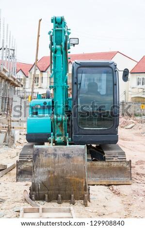 Land excavators green on construction site - stock photo