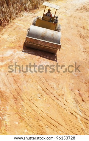 Land leveling machinery at construction site. - stock photo