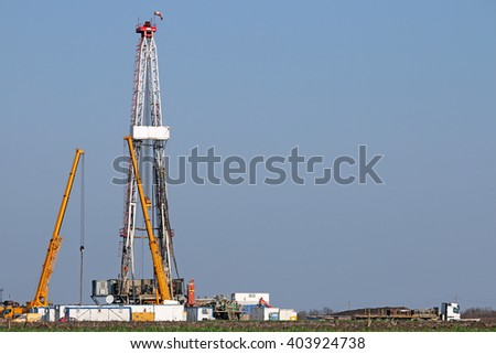 land oil drilling and cranes on oilfield