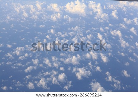 land sky clouds view from the plane - stock photo