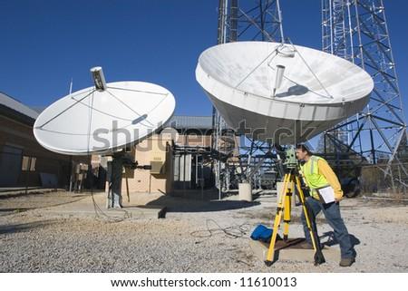 Land Surveyor at his work - stock photo