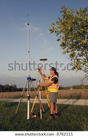 Land Surveyor with GPS unit. - stock photo