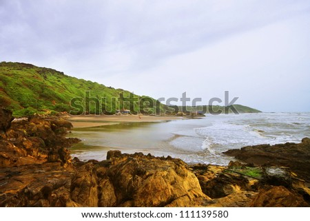Land water sky.Panoramic tropical beach and Arabian sea at Goa, India