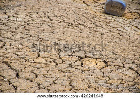Land with dry and cracked ground. Desert