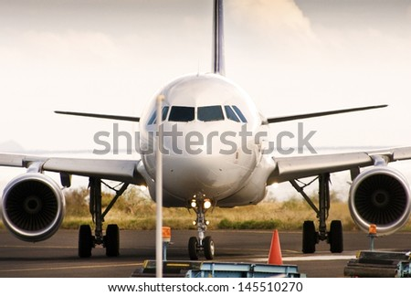 Landed Generic Commercial Airplane at Cargo Area