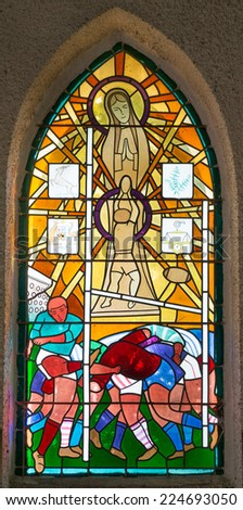 LANDES, FRANCE - SEPTEMBER 10, 2014: Stained glass window of the Notre Dame du Rugby, Landes, Aquitaine, France - stock photo