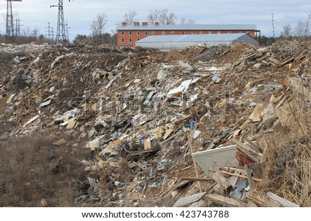 landfill construction waste. garbage dump. slope is littered with construction waste. construction waste.a lot of construction waste. - stock photo