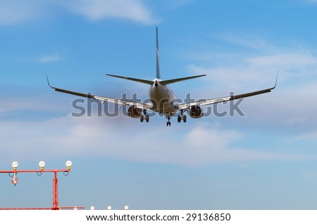 Landing aircraft exhausting the gas - stock photo