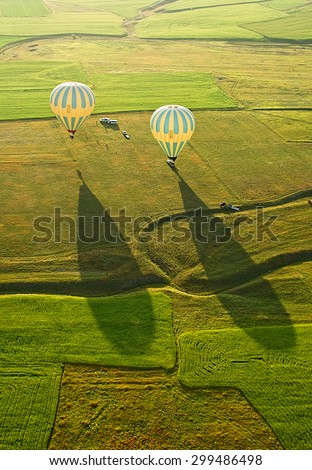 Landing balloon. Cappadocia is known around the world as one of the best places to fly with hot air balloons, Goreme, Cappadocia, Turkey.   - stock photo