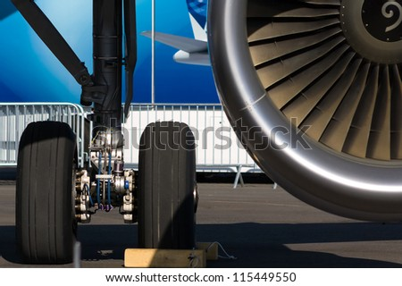 Landing gear, and a fragment of a jet engine. - stock photo