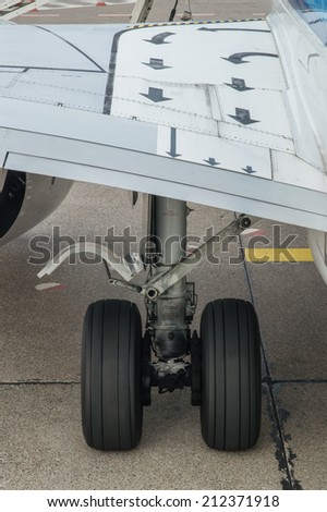 Landing gear of airplane - stock photo