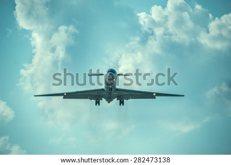 Landing of the passenger plane at evening time. - stock photo