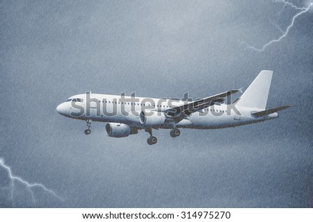 Landing of the passenger plane under the pouring rain. - stock photo
