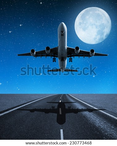 """Landing passenger airplane in night.  """"Elements of this image furnished by NASA"""".  - stock photo"""