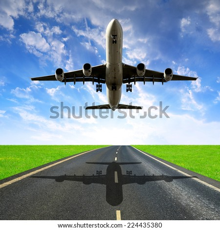 Landing passenger airplane in the sunset  - stock photo