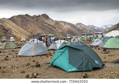 LANDMANNALAUGAR, ICELAND - August 03, 2017 : lot of tents on the campsite in the spectacular landscape landmannalaugar in iceland