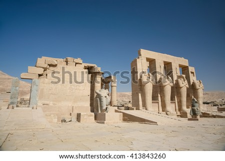landmark Egyptian Temple Ramesseum, monument memorial temple of pharaoh Ramesses II, with big sculptures and statues, in ancient Thebes, in Luxor, Egypt, Africa - stock photo