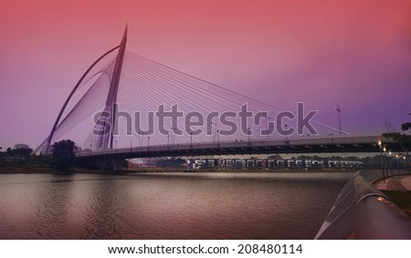 Landmark of modern silver steel bridge in Putrajaya, Malaysia. Asia - stock photo