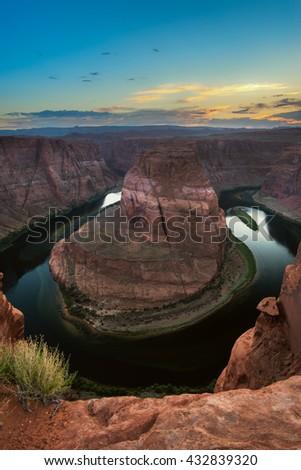 Landmark of Page, Arizona, The famous vista point Horseshoe Bend during sunset - stock photo