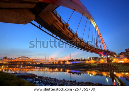 Landmark of Taipei, the famous rainbow bridge over Keelung River in the night, Taipei Taiwan, Asia. - stock photo