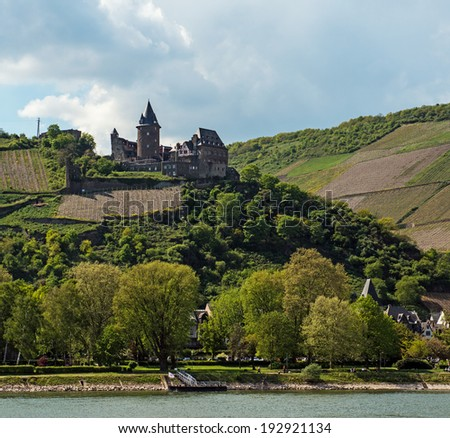 Landmark Stahleck castle surrounded by vineyards in the famous Rhine Gorge north of Rudesheim, Germany - stock photo