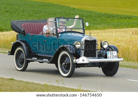 LANDSBERG, GERMANY - JULY 13: Oldtimer rallye for at least 80 years old antique cars with Chevrolet KK Cabrio, built at year 1925, photo taken on July 13, 2013 in Landsberg, Germany