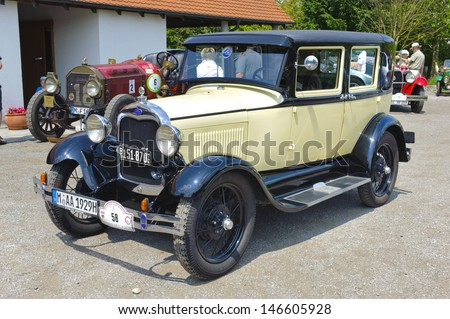 LANDSBERG, GERMANY - JULY 13: Oldtimer rallye for at least 80 years old antique cars with Ford A, built at year 1928, photo taken on July 13, 2013 in Landsberg, Germany