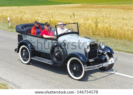 LANDSBERG, GERMANY - JULY 13: Oldtimer rallye for at least 80 years old antique cars with Ford A Phaeton, built at year 1929, photo taken on July 13, 2013 in Landsberg, Germany