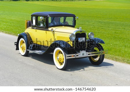 LANDSBERG, GERMANY - JULY 12: Oldtimer rallye for at least 80 years old antique cars with Ford A Coupe, built at year 1930, photo taken on July 12, 2013 in Landsberg, Germany - stock photo