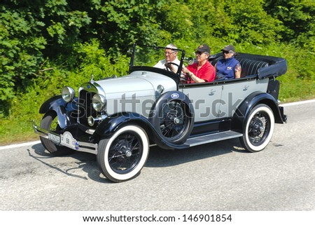LANDSBERG, GERMANY - JULY 13: Oldtimer rallye for at least 80 years old antique cars with Ford A Phaeton, built at year 1929, photo taken on July 13, 2013 in Landsberg, Germany - stock photo