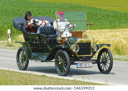 LANDSBERG, GERMANY - JULY 13: Oldtimer rallye for at least 80 years old antique cars with Ford T Touring, built at year 1910, photo taken on July 13, 2013 in Landsberg, Germany