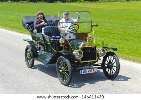 LANDSBERG, GERMANY - JULY 12: Oldtimer rallye for at least 80 years old antique cars with Ford T Touring, built at year 1910, photo taken on July 12, 2013 in Landsberg, Germany - stock photo