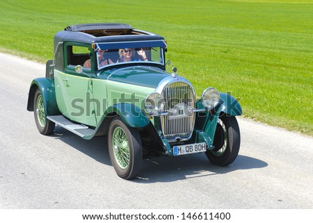 LANDSBERG, GERMANY - JULY 12: Oldtimer rallye for at least 80 years old antique cars with Hotchkiss Coupe Antibes, built at year 1930, photo taken on July 12, 2013 in Landsberg, Germany