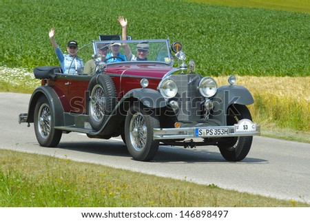 LANDSBERG, GERMANY - JULY 13: Oldtimer rallye for at least 80 years old antique cars with Mercedes 15/70/100, built at year 1927, photo taken on July 13, 2013 in Landsberg, Germany