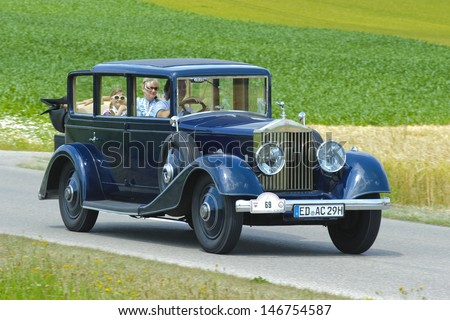 LANDSBERG, GERMANY - JULY 13: Oldtimer rallye for at least 80 years old antique cars with Rolls Royce Landaulet 20/25, built at year 1930, photo taken on July 13, 2013 in Landsberg, Germany