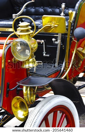 LANDSBERG, GERMANY - JULY 12, 2014: Public oldtimer rally in Bavarian city Landsberg for at least 80 years old veteran cars with a detail view of an antique car - stock photo