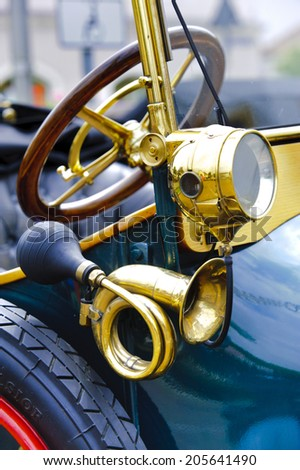 LANDSBERG, GERMANY - JULY 12, 2014: Public oldtimer rally in Bavarian city Landsberg for at least 80 years old veteran cars with a detail view of Ford Torpedo, built at year 1911 - stock photo