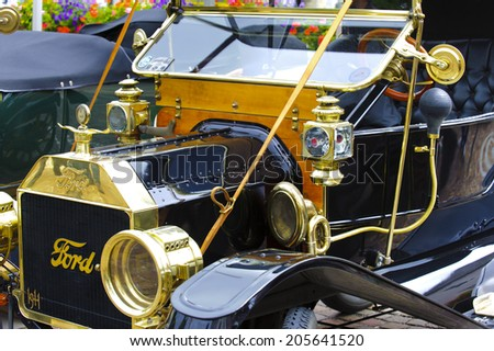 LANDSBERG, GERMANY - JULY 12, 2014: Public oldtimer rally in Bavarian city Landsberg for at least 80 years old veteran cars with a front view of Ford Torpedo, built at year 1911 - stock photo