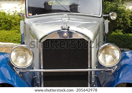 LANDSBERG, GERMANY - JULY 12, 2014: Public oldtimer rally in Bavarian city Landsberg for at least 80 years old veteran cars with a front view of Mercedes Stuttgart, built at year 1930 - stock photo