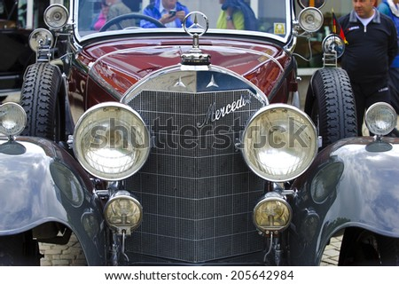 LANDSBERG, GERMANY - JULY 12, 2014: Public oldtimer rally in Bavarian city Landsberg for at least 80 years old veteran cars with a front view of Mercedes K15, built at year 1926 - stock photo